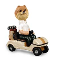 Pomeranian Red Golf Cart Doogie Collectable Figurine
