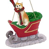Husky Red & White w/Blue Eyes Sleigh Ride Ornament