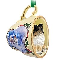 Sheltie Tricolor Tea Cup Sleigh Ride Holiday Ornament