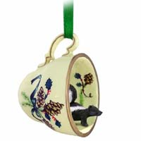 Skunk Tea Cup Green Holiday Ornament