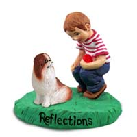 Japanese Chin Red & White Reflections w/Boy Figurine